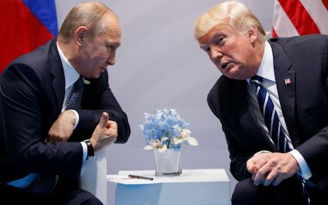 In this July 7, 2017, file photo, President Donald Trump meets with Russian President Vladimir Putin at the G-20 Summit in Hamburg - Credit: AP