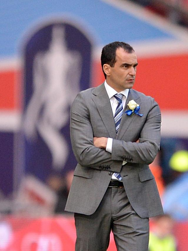 Wigan Athletic manager Roberto Martinez looks on from the touchline