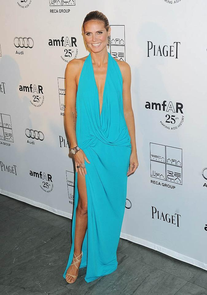 "Heidi Klum arrived at the 2nd Annual amFAR Inspiration Gala at the Museum of Modern Art in NYC on Tuesday night wearing a sexy turquoise gown featuring a plunging neckline and a thigh-high slit. Can you believe that she's a mother of four? Demis Maryannakis/<a href=""http://www.splashnewsonline.com/"" target=""new"">Splash News</a> - June 14, 2011"