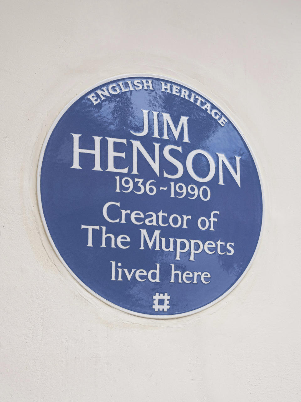 In this undated photo provided by English Heritage a view of the blue plaque on the former London home of Jim Henson, creator of The Muppets, who has been honoured with a blue plaque. The American creator of the Muppets was honored Tuesday, Sept, 7, 2021 in Britain with a blue plaque at his former home in north London, which he bought after 'The Muppet Show' was commissioned for British television — 50 Downshire Hill in Hampstead in north London to be precise. (English Heritage via AP)