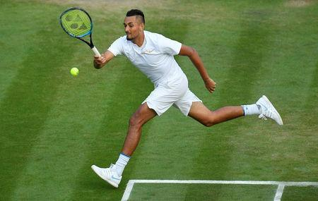 FILE PHOTO: Tennis - Wimbledon - All England Lawn Tennis and Croquet Club, London, Britain - July 7, 2018. Australia's Nick Kyrgios hits a shot during his third round match against Japan's Kei Nishikori. REUTERS/Toby Melville