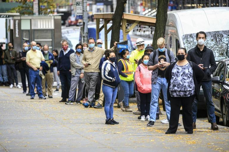 People line up outside a Covid-19 testing site in New York on November 11, 2020