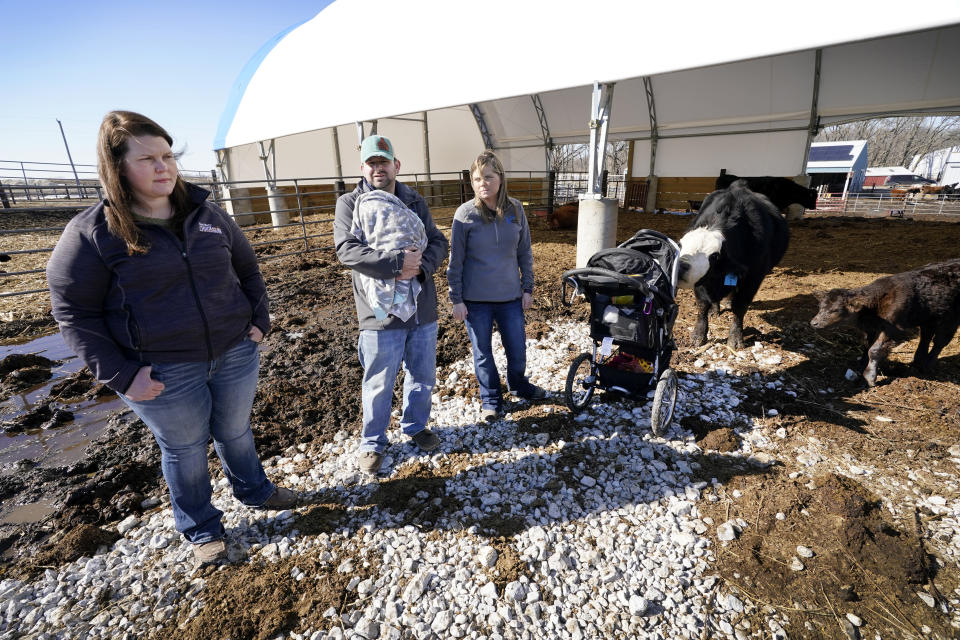 Vaughn Farms co-owners Jerilyn Hergenreder, left, Mat Vaughn and his wife Jalane Vaughn, talk about their specialty cattle operation, Tuesday, March 2, 2021, near Maxwell, Iowa. Sudden meat shortages last year because of the coronavirus led to millions of dollars in federal grants to help small meat processors expand so the nation could lessen its reliance on giant slaughterhouses to supply grocery stores and restaurants. (AP Photo/Charlie Neibergall)