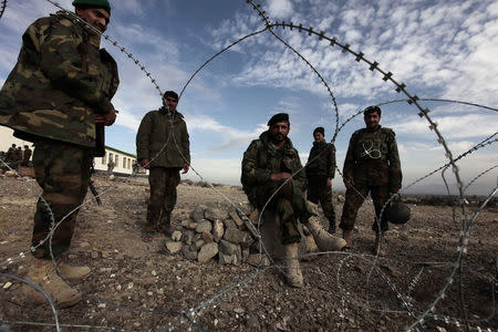 Afghan national army soldiers stand at their outpost at Shembawut village in Khowst province December 14, 2009. REUTERS/Zohra Bensemra