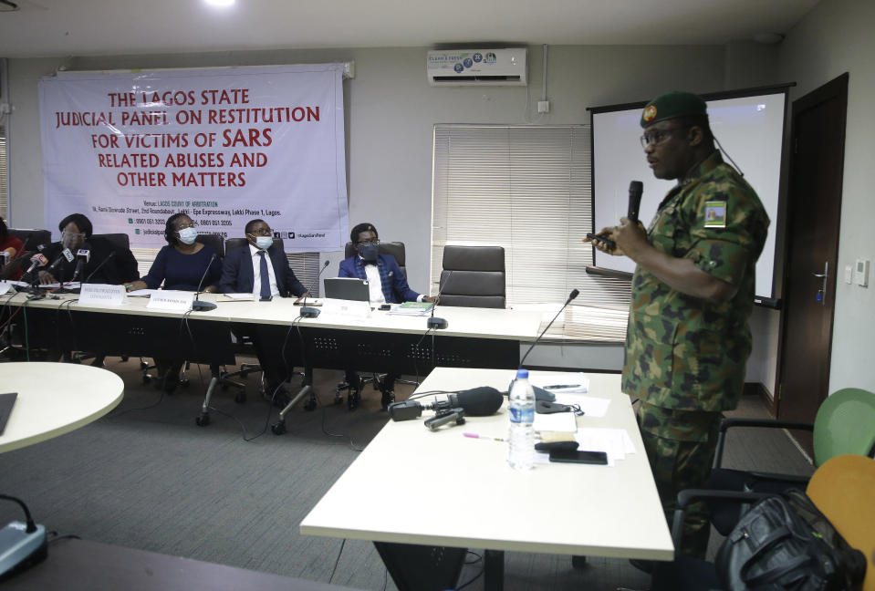 In this photo taken on Saturday Nov. 14, 2020. Brig. Gen. Ahmed Taiwo, Commander of the 81 Military Intelligence Brigade, speaks to a judicial committee over the weekend in Lagos Nigeria. Nigeria's army has said after weeks of denial that its troop did fire shots into the air to disperse a large crowd at the Lekki Toll Plaza in Lagos where several peaceful protesters were killed late in October. (AP Photo/Sunday Alamba)