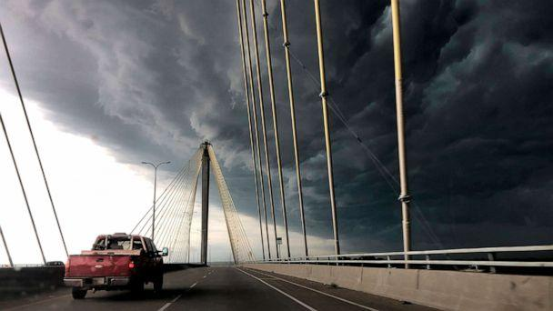 PHOTO: A truck drives east out of Alton, Ill., over the Clark Bridge as clouds from a severe warned thunderstorm roll in on Wednesday, July 17, 2019. (David Carson/St. Louis Post-Dispatch via AP)