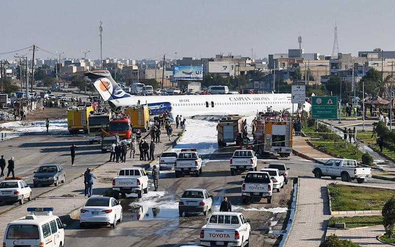 Caspian Airlines aircraft which landed on a highway after it overshot the highway during its approach inin Iran's southwestern city of Bandar-e Mahshahr - AFP
