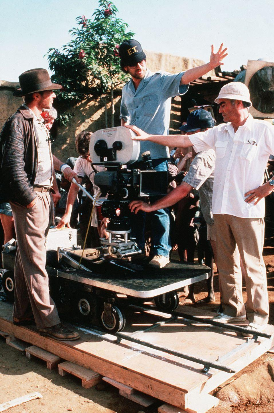 <p>Ford and Spielberg on the set of <em>Indiana Jones and The Last Crusade</em>.</p>