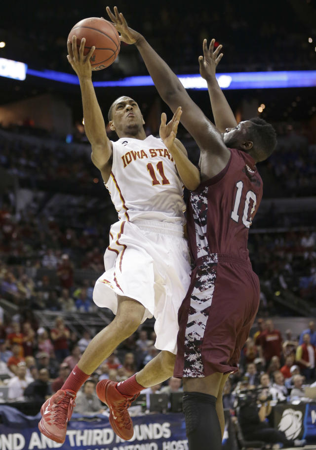 Iowa State guard Mont Morris (11) shoots over North Carolina Central forward Karamo Jawara (10) during the first half of a second-round game in the NCAA college basketball tournament Friday, March 21, 2014, in San Antonio. (AP Photo/David J. Phillip)