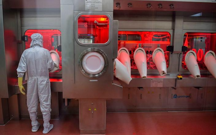 A worker on the vaccine production line at the Serum Institute of India - Punit Paranjpe/AFP