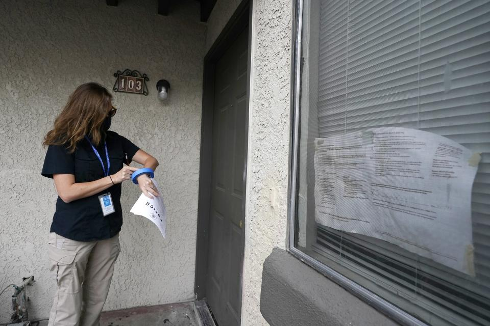 Pima County Constable Kristen Randall arrives at an apartment complex to speak to a rental resident about their eviction case Friday, Sept. 24, 2021, in Tucson, Ariz. Long delayed evictions are rolling out more than a month after the end of a federal moratorium that had protected tenants, including some who hadn't paid rent for many months during the coronavirus pandemic. (AP Photo/Ross D. Franklin)