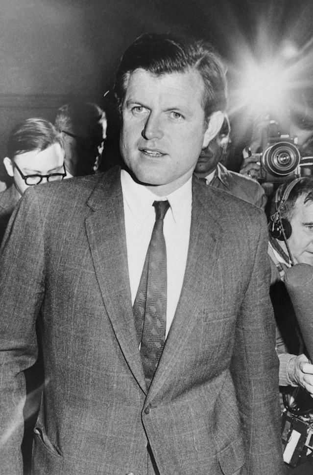<p>Sen. Edward Kennedy is trailed by reporters and cameraman as he arrived at Logan International Airport in Boston, Mass. Earlier in the day the Massachusetts Supreme Court announced they have granted Senator Kennedy's request for a closed hearing into the death of Mary Jo Kopechne. (Photo: Bettmann/Getty Images) </p>