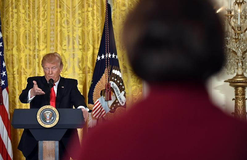 """""""The press has become so dishonest that if we don't talk about it, we are doing a tremendous disservice to the American people,"""" said Trump at his first solo press conference on February 16, 2017 (AFP Photo/Nicholas Kamm                       )"""