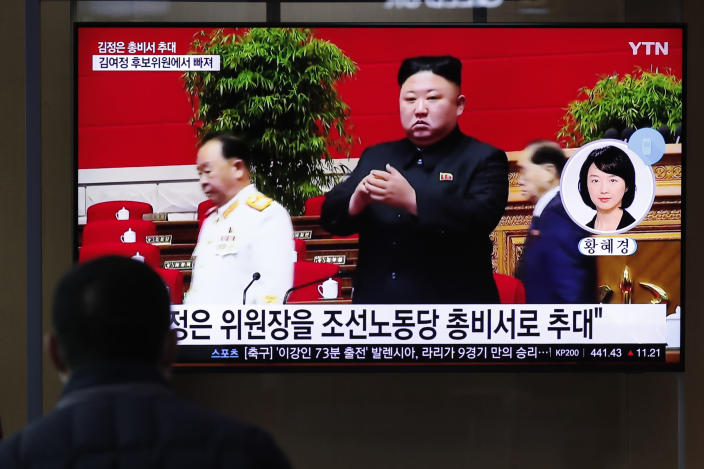 """A man watches a TV screen showing a footage of North Korean leader Kim Jong Un, at the Seoul Railway Station in Seoul, South Korea, Monday, Jan. 11, 2021. A part of letters read """"North Korean leader Kim Jong Un was given a new title, general secretary of the ruling Workers' Party."""" (AP Photo/Lee Jin-man)"""