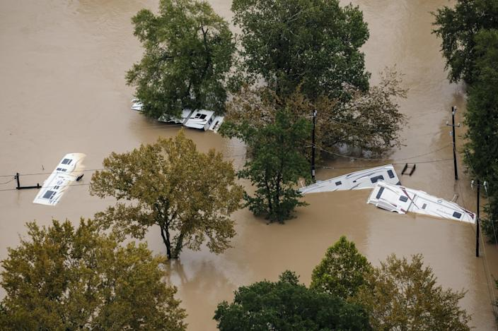 <p>Recreational vehicles sit on their sides in flood water in the wake of Hurricane Harvey on August 29, 2017 in Houston, Texas. (Photo: Marcus Yam / Los Angeles Times via Getty Images) </p>