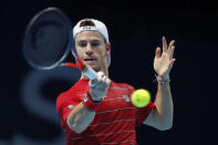Diego Schwartzman of Argentina plays a return to Alexander Zverev of Germany during their tennis match at the ATP World Finals tennis tournament at the O2 arena in London, Wednesday, Nov. 18, 2020. (AP Photo/Frank Augstein)