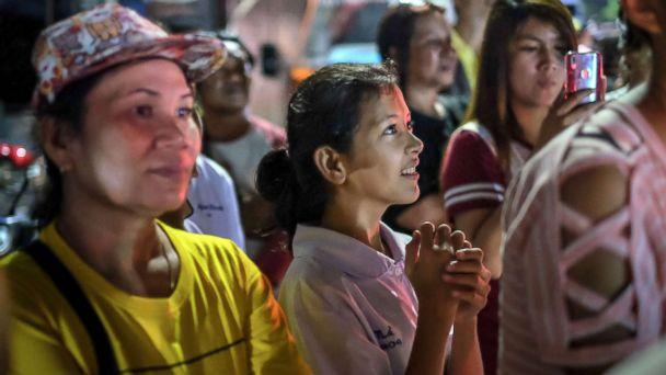 PHOTO: Onlookers at the junction in front of Chiangrai Prachanukroh Hospital watch and cheer as ambulances transport the last rescued schoolboys and their coach, July 10, 2018, in Chiang Rai, Thailand. (Linh Pham/Getty Images)