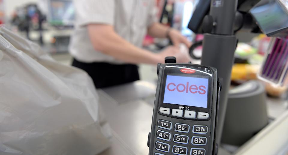 Coles Eftpos machine at the checkout.