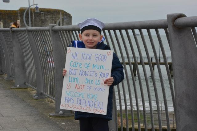 Six-year-old Oscar gets ready to welcome his father home