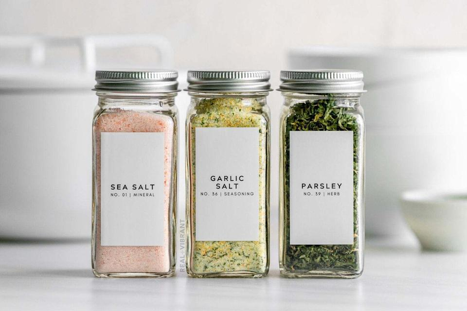 """Available in sets of 20, 40 or 80, depending on how extensive your spice collection is, you'll be able to see everything laid out neatly — and you can just buy in bulk to refill!<br /><br />Real and Vibrant is an Etsy shop owned and founded by Sapana Chandra, an author, recipe developer and food blogger (her blog is also called<a href=""""https://realandvibrant.com/"""" target=""""_blank"""" rel=""""nofollow noopener noreferrer"""" data-skimlinks-tracking=""""5883859