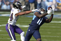 Tennessee Titans wide receiver A.J. Brown (11) makes a catch as he is defended by Baltimore Ravens cornerback Marlon Humphrey (44) in the first half of an NFL wild-card playoff football game Sunday, Jan. 10, 2021, in Nashville, Tenn. (AP Photo/Mark Zaleski)