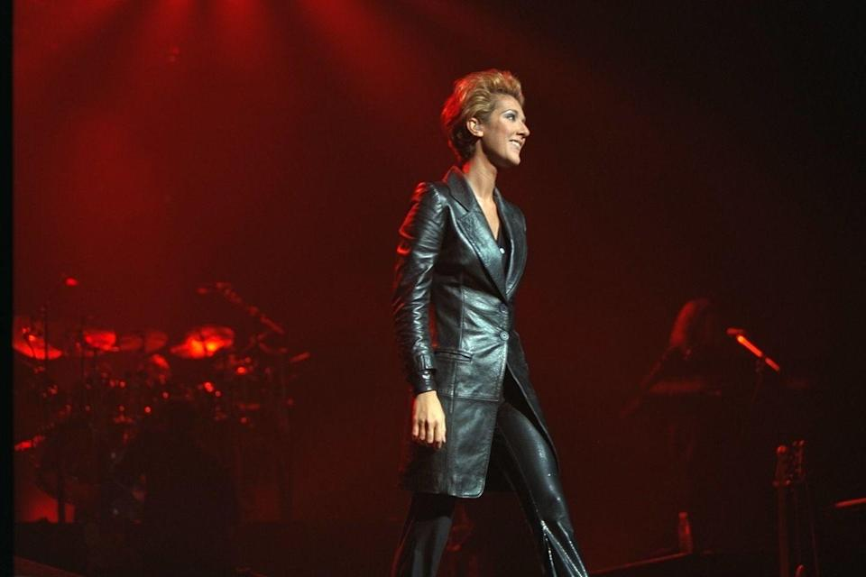 <p>Another 90s leather moment in the books. This time, Celine wore form-fitting leather pants and a leather single-breasted trench coat. This combined with her blown-out hair give us major Harley-Davidson vibes.</p>