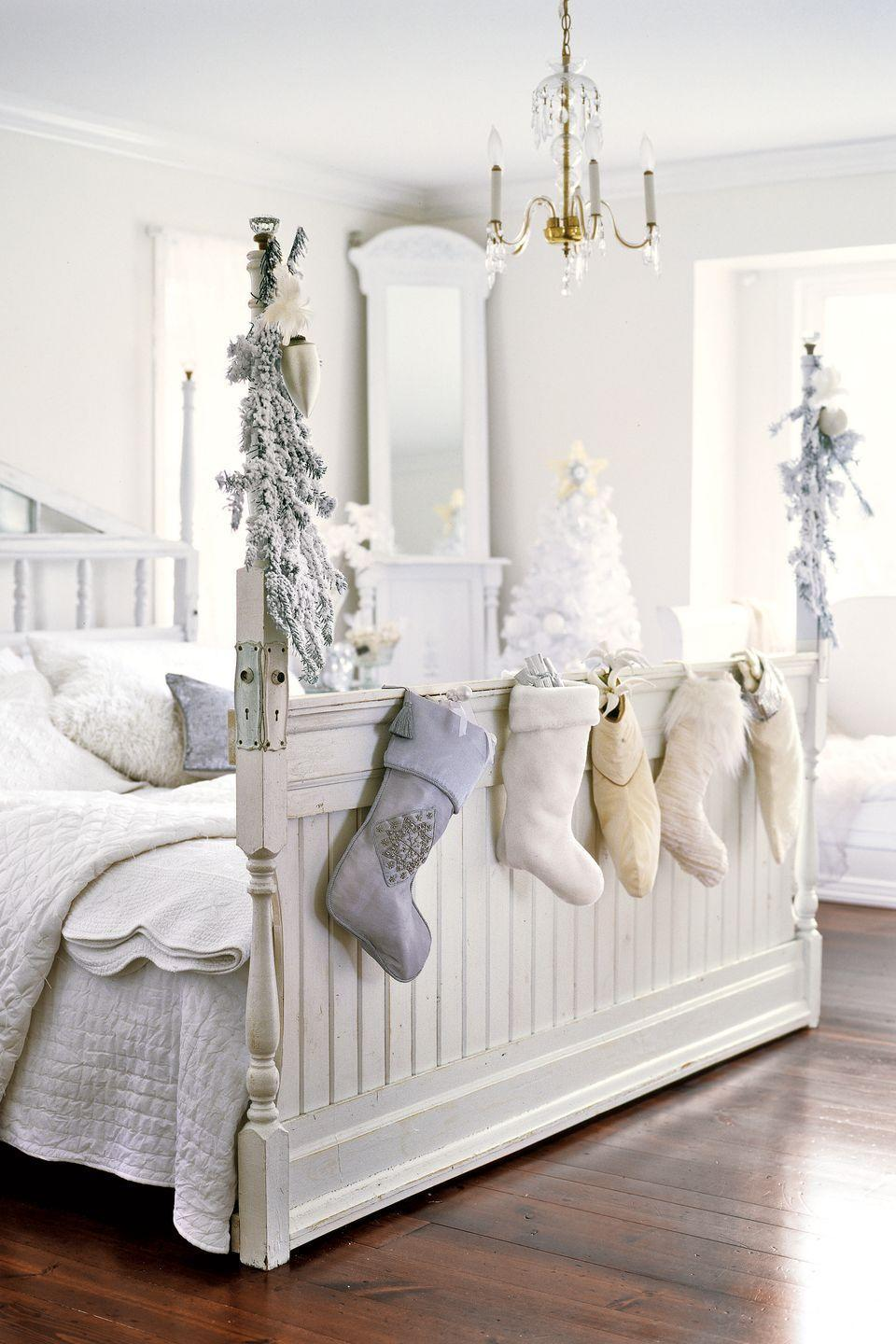"""<p>Who says stockings have to go on the mantel? Hang yours at the foot of your bed for easy access on Christmas morning.</p><p><a class=""""link rapid-noclick-resp"""" href=""""https://www.amazon.com/Stockings-Holders-Metal-Seasonal-D%C3%A9cor/s?ie=UTF8&page=1&rh=n%3A13744821%2Cp_n_material_browse%3A316589011&tag=syn-yahoo-20&ascsubtag=%5Bartid%7C10050.g.1247%5Bsrc%7Cyahoo-us"""" rel=""""nofollow noopener"""" target=""""_blank"""" data-ylk=""""slk:SHOP STOCKING HOOKS"""">SHOP STOCKING HOOKS</a><br></p>"""