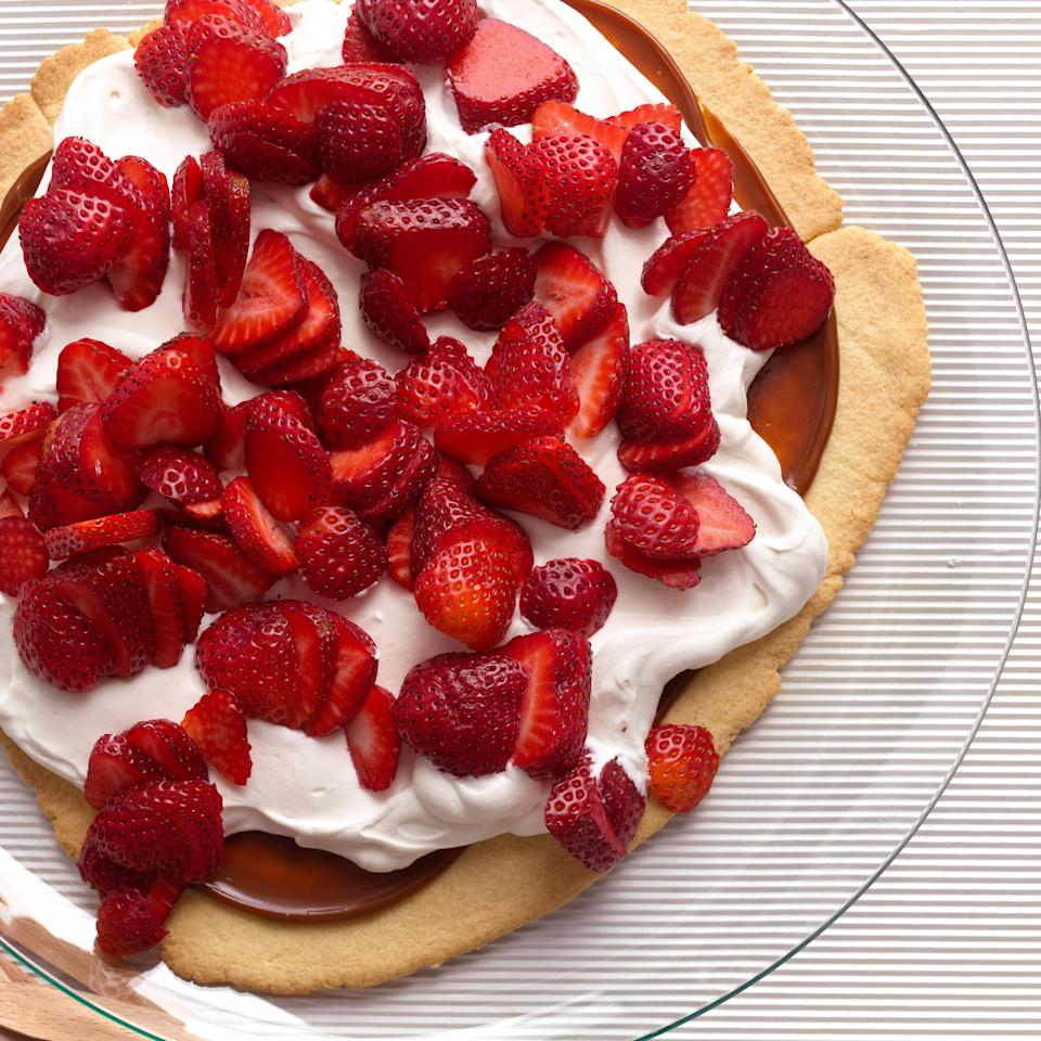 "One big, flat cookie base is spread with dulce de leche and then topped with a soft pillow of whipped cream and freshly sliced strawberries in this easier-than-pie dessert. <a href=""https://www.epicurious.com/recipes/food/views/simple-strawberry-dulce-de-leche-shortbread-tart-395010?mbid=synd_yahoo_rss"" rel=""nofollow noopener"" target=""_blank"" data-ylk=""slk:See recipe."" class=""link rapid-noclick-resp"">See recipe.</a>"