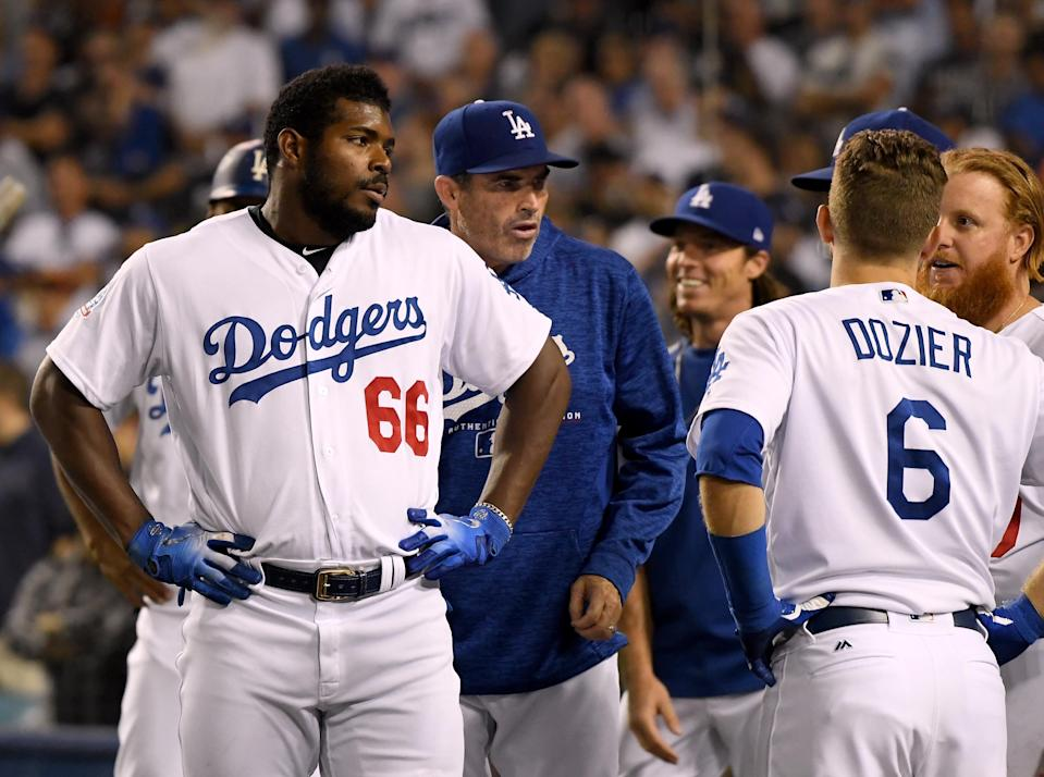 Yasiel Puig of the Los Angeles Dodgers reacts after an altercation with Nick Hundley of the San Francisco Giants leading to an ejection for both players during the seventh inning at Dodger Stadium on August 14, 2018 in Los Angeles, California. (Harry How/Getty Images)