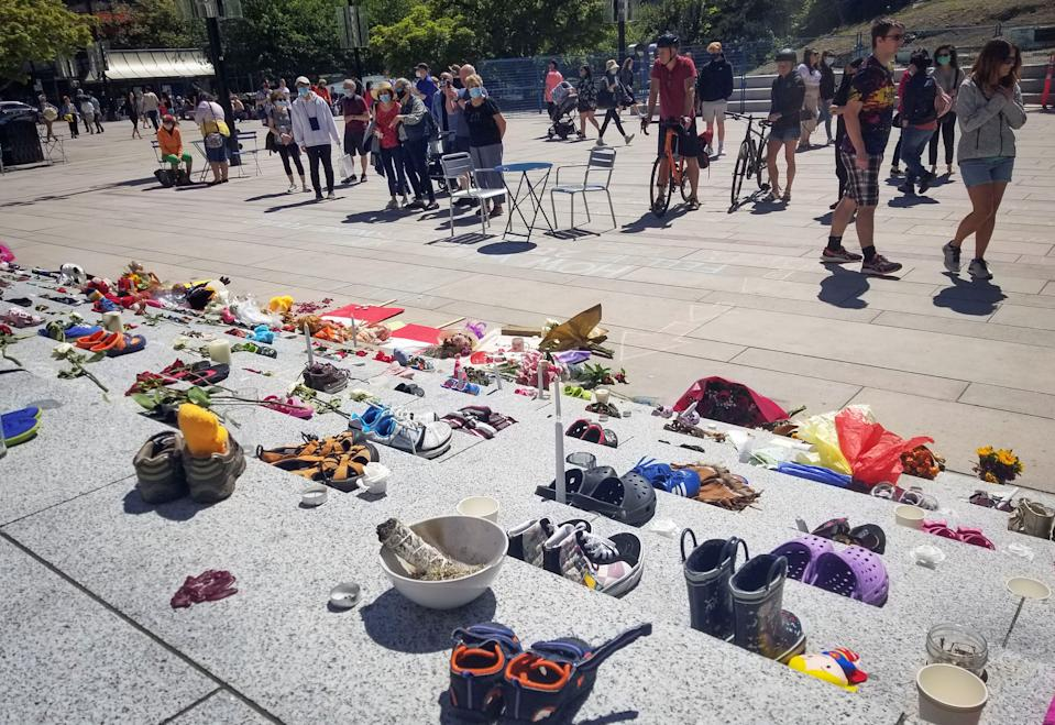 <p>Children's shoes are placed on the staircase outside Vancouver Art Gallery during a memorial event for the 215 children whose remains have been found buried at a former Kamloops residential school in Vancouver, British Columbia, Canada, May 29, 2021.The reported discovery of the remains of 215 indigenous children at a former residential school in Kamloops in western Canada has shocked Canadian people.In a press release on Friday, the British Columbia Assembly of First Nations said it is grieving the location of the 215 children. (Photo by Liang Sen/Xinhua via Getty Images)</p>