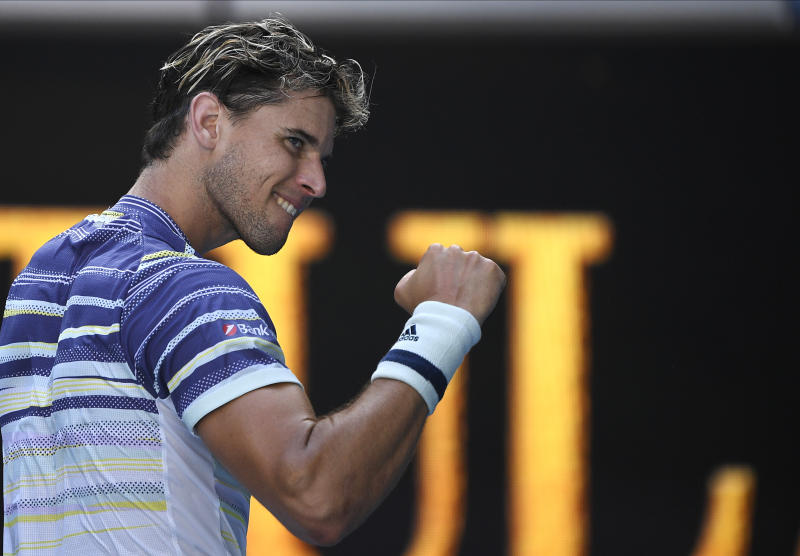 Austria's Dominic Thiem reacts after defeating Taylor Fritz of the U.S. in their third round singles match at the Australian Open tennis championship in Melbourne, Australia, Saturday, Jan. 25, 2020. (AP Photo/Andy Brownbill)