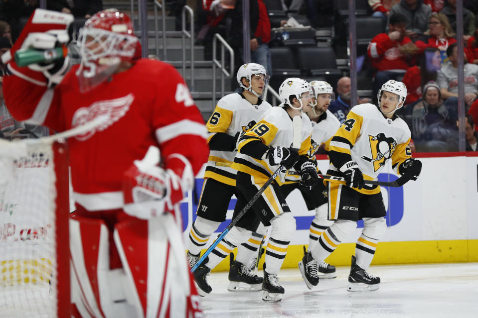 Pittsburgh Penguins center Dominik Kahun, right, celebrates his goal with teammates against the Detroit Red Wings in the third period of an NHL hockey game Saturday, Dec. 7, 2019, in Detroit. (AP Photo/Paul Sancya)