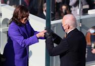 WASHINGTON, DC - JANUARY 20: Vice President Kamala Harris celebrates with President-elect Joe Biden after being sworn in during the inauguration on the West Front of the U.S. Capitol on January 20, 2021 in Washington, DC. During today's inauguration ceremony Joe Biden becomes the 46th president of the United States. (Photo by Tasos Katopodis/Getty Images)