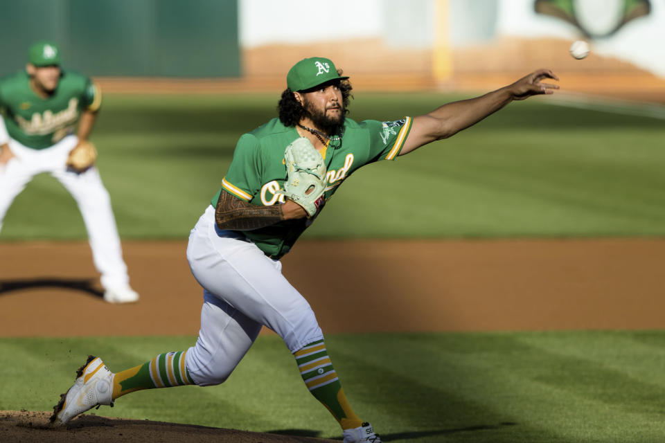 Oakland Athletics starting pitcher Sean Manaea throws against the Los Angeles Angels during the first inning of a baseball game in Oakland, Calif., Monday, June 14, 2021. (AP Photo/John Hefti)
