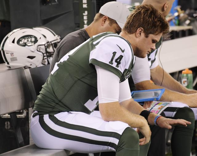 New York Jets quarterback Sam Darnold (14) looks at his hand after hurting it during the first half of a preseason NFL football game against the Atlanta Falcons, Friday, Aug. 10, 2018, in East Rutherford, N.J. (AP Photo/Bill Kostroun)