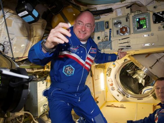 Scott Kelly with flight engineer Sergey Volkov from the International Space Station in 2016 (Reuters)