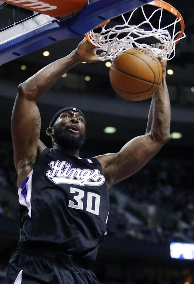Sacramento Kings forward Royce White (30) dunks the ball against the Detroit Pistons during the first half of an NBA basketball game, Tuesday, March 11, 2014, in Auburn Hills, Mich. (AP Photo/Duane Burleson)
