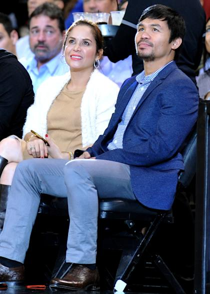 Boxer Manny Pacquiao (R) watches an NBA game with his wife, Jinkee. (Steve Mitchell-USA TODAY Sports)