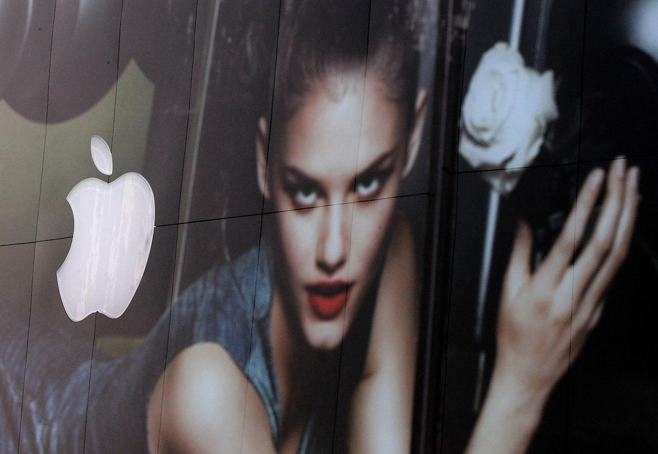 SAN FRANCISCO, CA - APRIL 24:  The Apple logo is seen reflected in the window of a clothing store on April 24, 2012 in San Francisco, California. Based on high sales of the iPhone and iPad, Apple reported a 93 percent surge in second quarter earnings with a profit of $11.6 billion, or $12.30 per share compared to $6.0 billion, or $6.40 per share one year ago.  (Photo by Justin Sullivan/Getty Images)