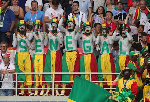 <p>Senegalese fans with painted faces spell out the name Senegal during a First Stage Group H football match between Poland and Senegal at Spartak Stadium at FIFA World Cup Russia 2018. Sergei Bobylev/TASS (Photo by Sergei Bobylev\TASS via Getty Images) </p>