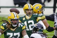 Green Bay Packers' Aaron Rodgers throws during the first half of an NFL football game against the Jacksonville Jaguars Sunday, Nov. 15, 2020, in Green Bay, Wis. (AP Photo/Mike Roemer)