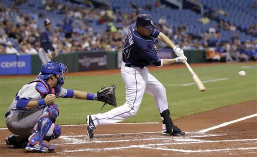 Tampa Bay Rays' Drew Sutton lines a two-run double off Toronto Blue Jays starting pitcher Ricky Romero during the first inning of a baseball game, Wednesday, May 23, 2012, in St. Petersburg, Fla. Rays' Carlos Pena, and Matt Joyce scored on the hit. Catching for Toronto is J.P. Arencibia. (AP Photo/Chris O'Meara)