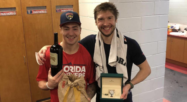 Panthers' Frank Vatrano (left) poses with teammate Sergei Bobrovsky (right) and the gifts he received from the Russian goaltender after giving up his number. (Instagram//@frank_vatrano)