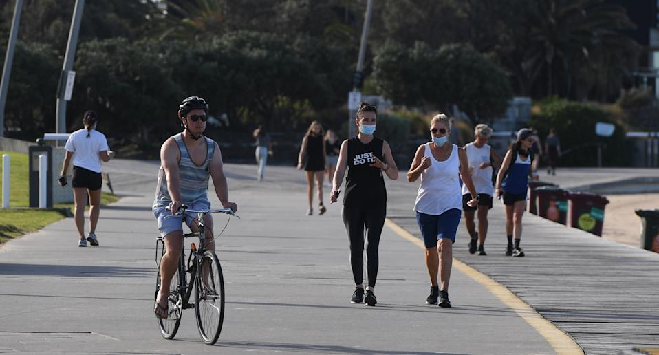 People exercising at St Kilda Beach in Melbourne