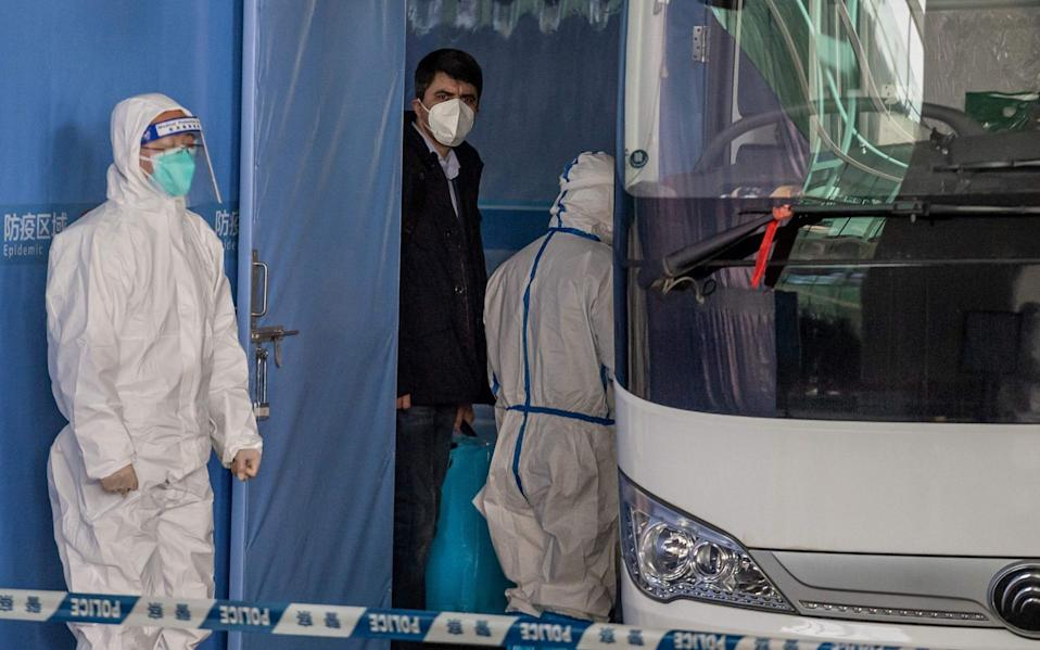 World Health Organisation investigators arriving at the airport at Wuhan earlier this month - Nicholas Asfouri/AFP
