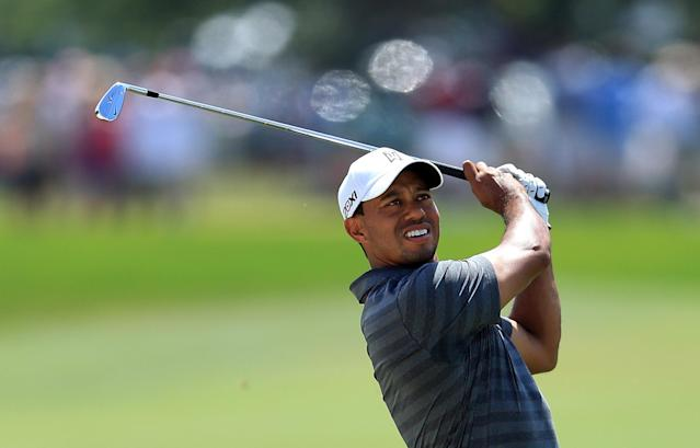ORLANDO, FL - MARCH 24: Tiger Woods of the USA plays his second shot at the par 4, 1st hole during the third round of the 2012 Arnold Palmer Invitational presented by MasterCard at Bay Hill Club and Lodge on March 24, 2012 in Orlando, Florida. (Photo by David Cannon/Getty Images)
