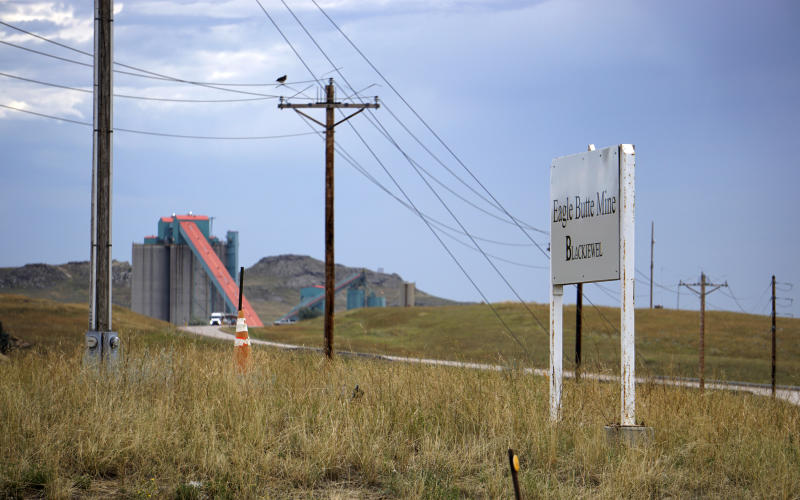 In this Friday, Sept. 6, 2019 photo shows the Eagle Butte mine just north of Gillette, Wyo. The shutdown of Blackjewel LLC's Belle Ayr and Eagle Butte mines in Wyoming since July 1, 2019 has added yet more uncertainty to the Powder River Basin's struggling coal economy. (AP Photo/Mead Gruver)