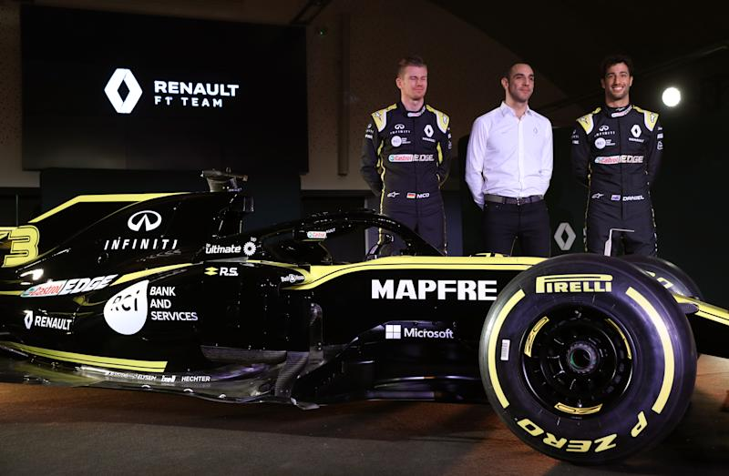 Drivers Niko Hulkenberg (left) and Daniel Ricciardo with Renault Managing Director Cyril Abiteboul during the Renault F1 Team 2019 season launch at Whiteways Technical Centre, Oxford. (Photo by Andrew Matthews/PA Images via Getty Images)