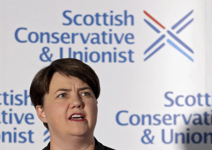 Leader of the Scottish Conservatives Ruth Davidson at the podium during a press conference to announce that she has resigned as leader of the Scottish Conservatives, in Edinburgh, Scotland, Thursday Aug. 29, 2019. Davidson resigns as Scottish Conservative Party leader amid political firestorm on Brexit, and cites family reasons for her decision to stand down. (Jane Barlow/PA via AP)