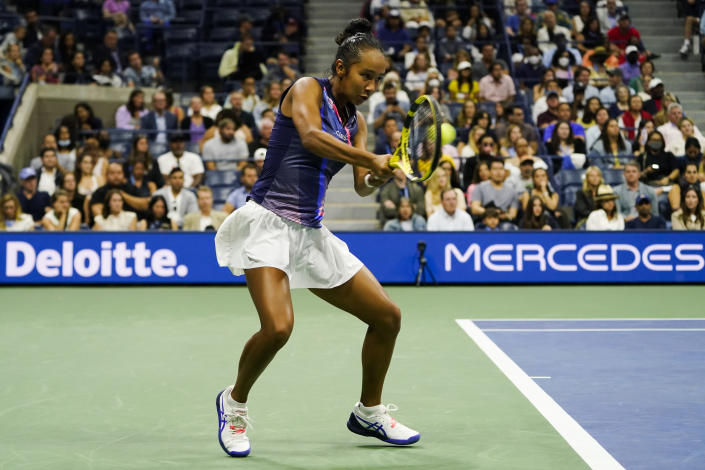 Leylah Fernandez, of Canada, returns a shot to Naomi Osaka, of Japan, during the third round of the US Open tennis championships, Friday, Sept. 3, 2021, in New York. (AP Photo/John Minchillo)